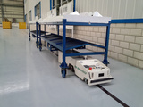 AGV carrying components at factory