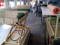 4 way directional load transfer belt conveyor lift AGV working in a textile factory